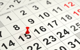 Red pin marking the 15th on a calendar Stock Image