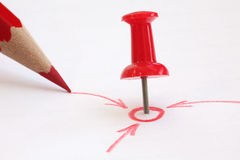 Red pin and pencil  show your goal. This photo tells us you'll be successful in different directions Stock Photography