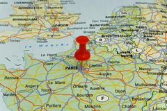 Red pin pointing on paris Royalty Free Stock Images