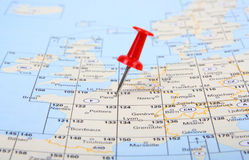 Red pin show the location of a destination point o. N a map, little focus Stock Images