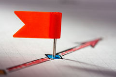 Red pin on sketched red arrow Royalty Free Stock Image