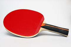 Red ping pong paddle on a white background Stock Images