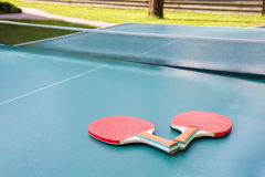 Red ping pong rackets Royalty Free Stock Photography