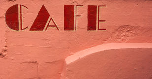 Red on pink cafe sign Royalty Free Stock Photo