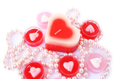 Red and pink candles with necklace Royalty Free Stock Image
