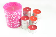 Red and pink candles on white background.  Stock Image