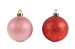 Red and pink christmas baubles on white background Royalty Free Stock Images