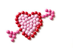 Red and Pink Coated Candy shaped in a heart isolated on white ba Royalty Free Stock Photography