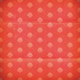 Red and pink damask grunge wallpaper. Weathered trendy red and pink damask wallpaper with spots royalty free stock images