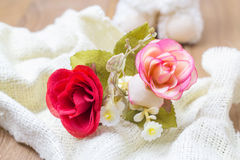 Red and pink fabric rose on white fabric Royalty Free Stock Photo