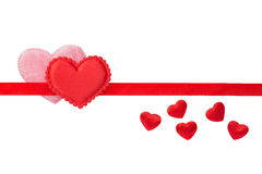 Red and Pink fluffy hearts on red strip Royalty Free Stock Image