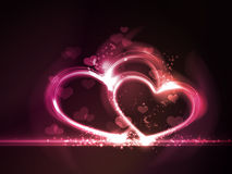 Red pink glowing hearts frame. Overlying semitransparent heart shapes with light effects form glowing hearts frame in shades of pink, purple and red on dark red Stock Image