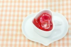 Red and pink heart and heart shaped coffee cup Royalty Free Stock Images