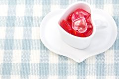 Red and pink heart and heart shaped coffee cup Stock Images