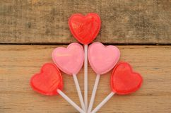 Red and pink heart shaped lollipops in floral shape Stock Image