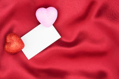 Red and pink  heart with a white card Royalty Free Stock Photos