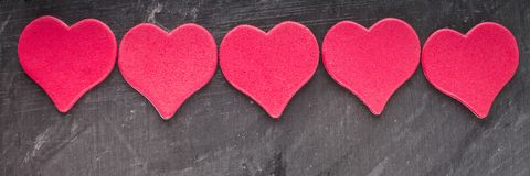 Red and pink hearts on grey background. Red and pink hearts on grey background royalty free stock photos