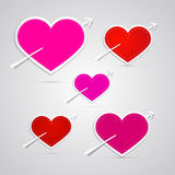 Red, pink hearts pierced with arrows Royalty Free Stock Images