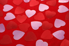 Red and pink hearts on red textiles. Valentine background Stock Image