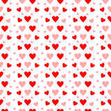 Red and pink hearts in seamless pattern on white Stock Photo
