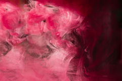 Red pink ink in water. Sunshine lighting. Dynamic movement of pa Stock Photo