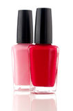 Red and pink nail polish on a white Royalty Free Stock Photography
