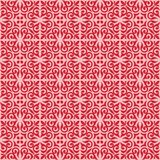Red on pink ornamental scroll seamless repeat pattern background. Two colour ornamental scroll with dagger fleur de lis seamless repeat pattern background. Could Royalty Free Stock Image
