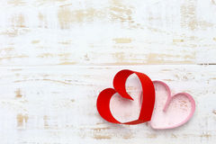 Red and pink paper heart on white wood Stock Image