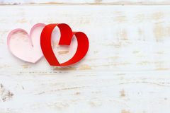 Red and pink paper heart on white wood Stock Photography