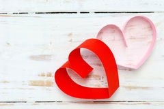Red and pink paper heart on white wood Royalty Free Stock Image