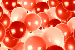 Red and pink party balloons background. Royalty Free Stock Photo