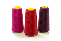Red pink and purple bobbin with thread Royalty Free Stock Image