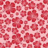 Red on pink random hibiscus flower seamless repeat pattern background. Two colour random hibiscus flower seamless repeat pattern background. Could be used for Stock Image