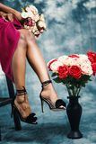 Red and Pink Rose Flower Bouquet at Woman's Hand stock image