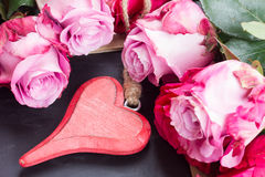 Red and pink  roses  on table Royalty Free Stock Photo