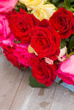 Red and pink  roses  on table Stock Photos