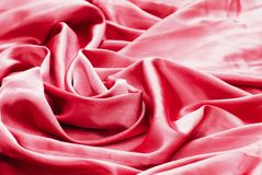 Red or pink silk drapery and upholstery fabric from the courtyard stock photos