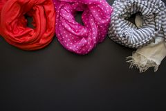 Scarves on a black background royalty free stock photography