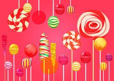 Red pink sugar background with bright colorful lollipops candy sweets. Candy shop. Sweet color lollipop. Stock Image
