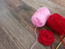 Red and pink thread knitting stock images