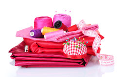 Red and pink thread, measuring tape and fabric Royalty Free Stock Photos
