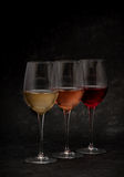 Red, pink, white wine on black background Stock Photo