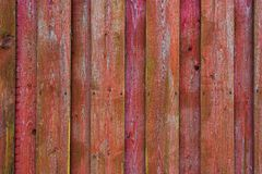 Red and pink wooden surface made of plaited boards Royalty Free Stock Photography