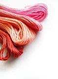 Red and pink yarn, white background stock photos