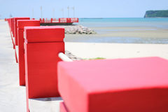 Red pins on the beach Royalty Free Stock Image