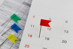 Red Pins to Wildcats on the calendar beside the number of eighte Royalty Free Stock Photo
