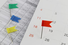 Red Pins to Wildcats on the calendar beside the number of twenty Royalty Free Stock Photography