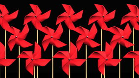 Red Pinwheels On Black Background stock video