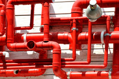 Red pipe in complex circuity Stock Image