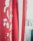 Red old scraped paint pipe on the rooftop stock images
